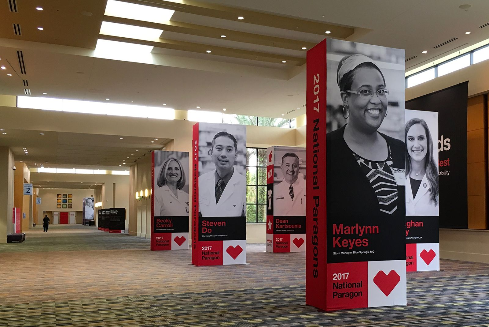 large scale banners of CVS Health personnel during retail leadership conference