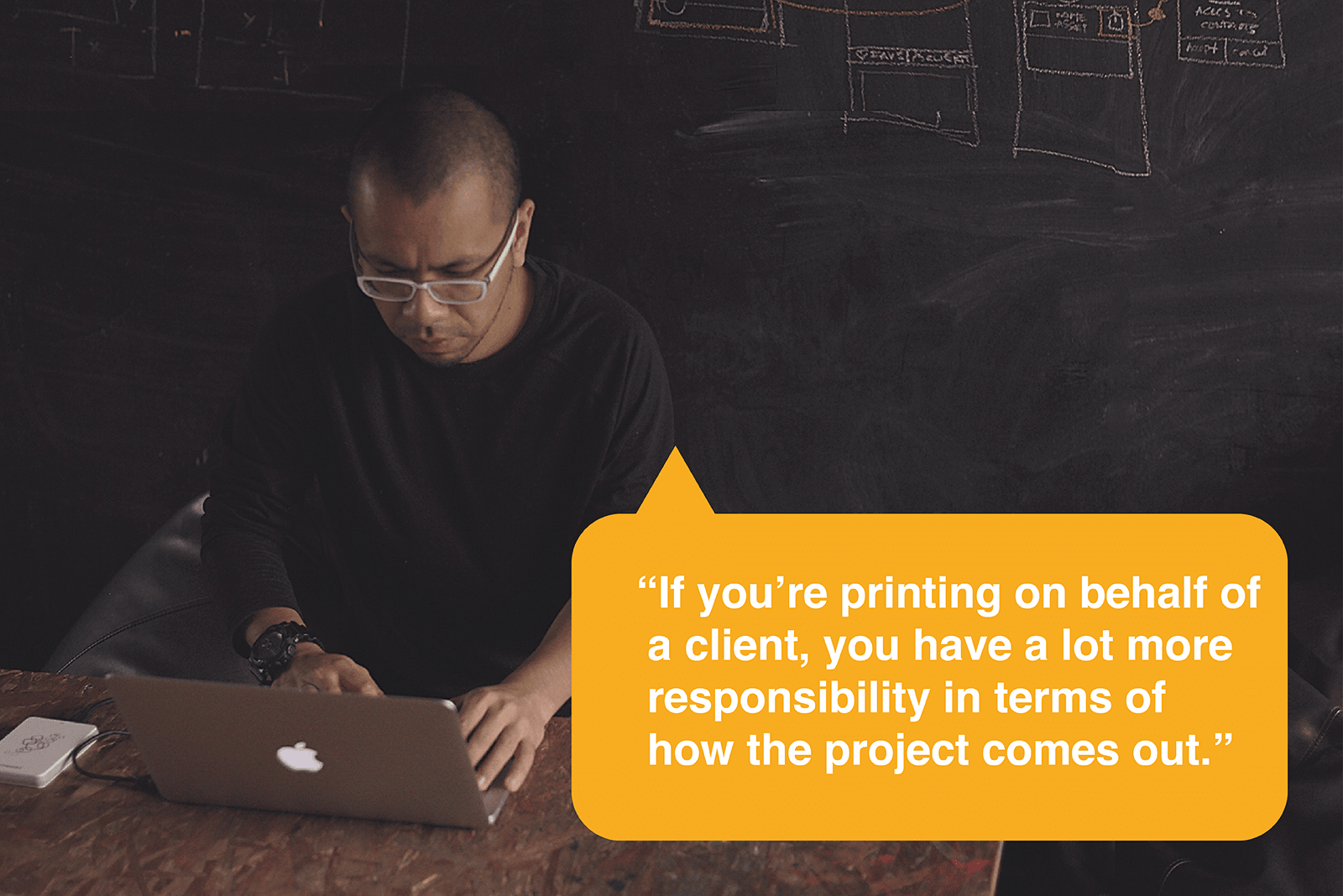 man sketching with quote overlay about the importance of design quality