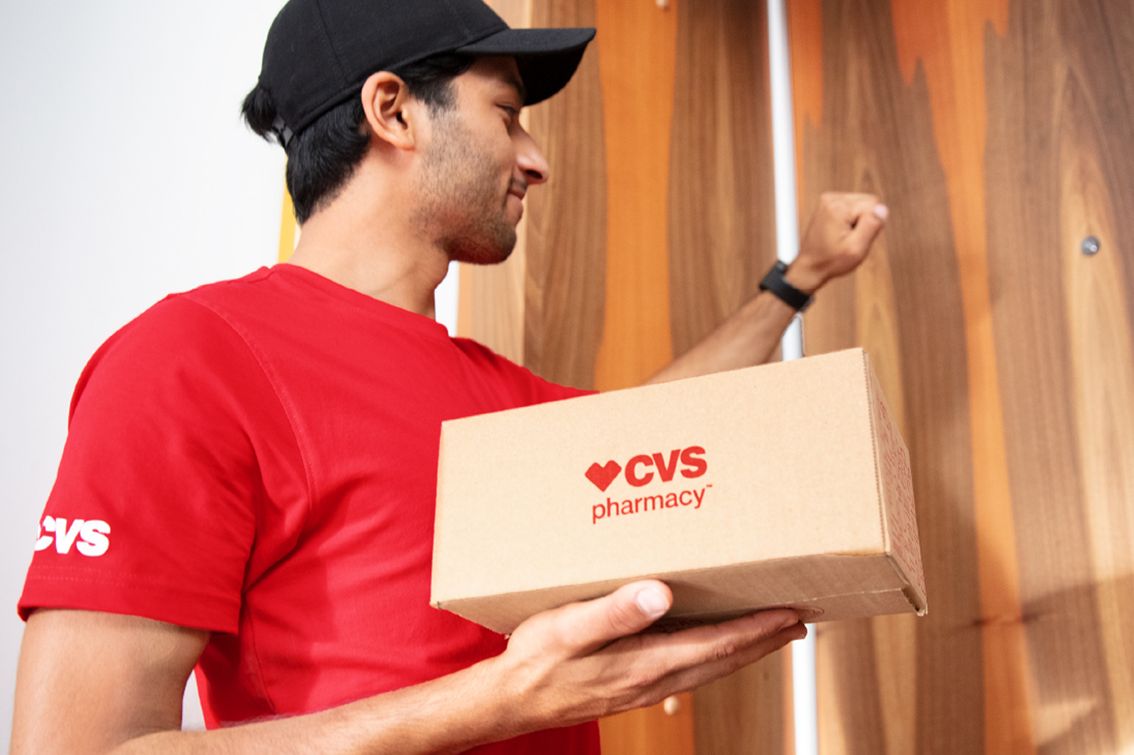 Delivery worker delivering a CVS Health package